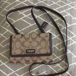 Small brown Coach handbag